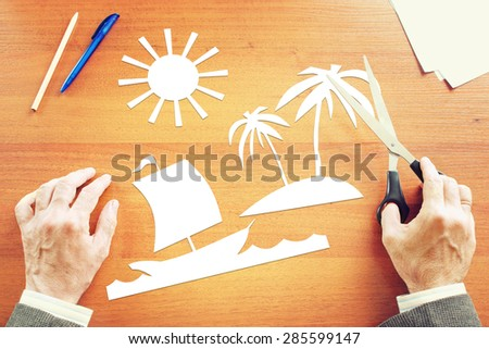 Office clerk dreaming about vacation on the seaside - stock photo
