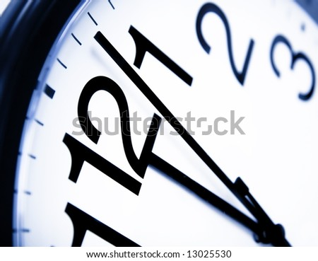 Office clock about to show 12'o clock - good metaphor for running out of time - stock photo