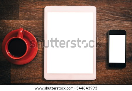 Office concept with blank screens on wooden background - stock photo