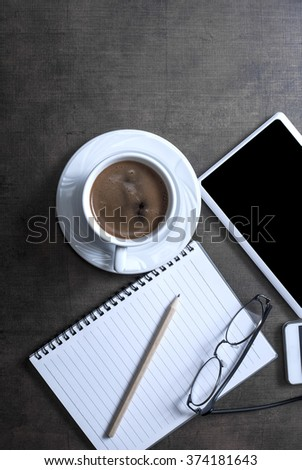 Office concept with blank screens on wooden background, from above - stock photo