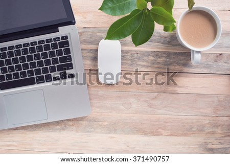 office desk a cup of coffee and computer laptop.  - stock photo