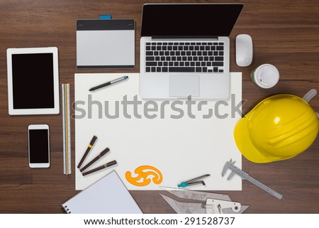 Office desk background with construction project ideas concept, With laptop computer, drawing equipment and cup of coffee. View from above with copy space - stock photo