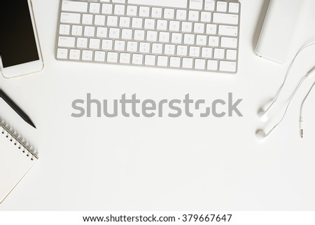Office desk, keyboard, mobile, paper, object with area for text or product display view from above - stock photo