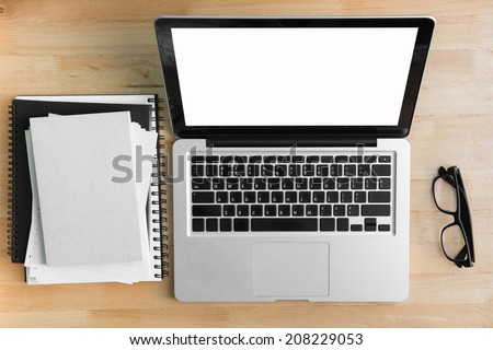 Office desk,Laptop Working on a Wooden Table  - stock photo
