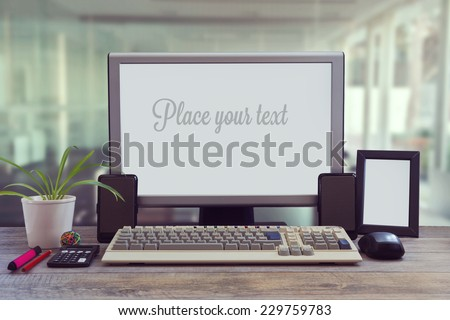 Office desk mock up with blank screen - stock photo