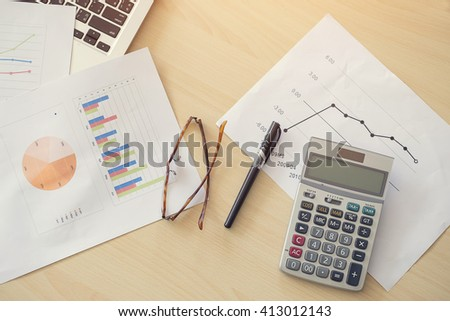 Office desk table with computer,calculator,document. - stock photo