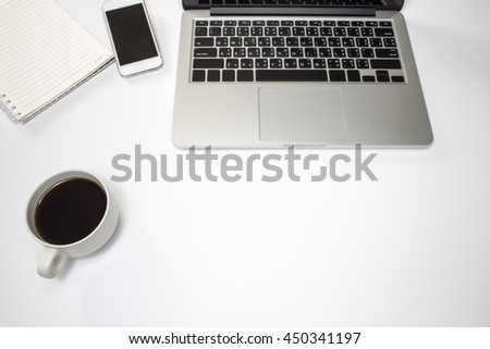 Office desk table with computer,Note book,smart-phone, supplies and coffee cup. Top view with copy space - stock photo