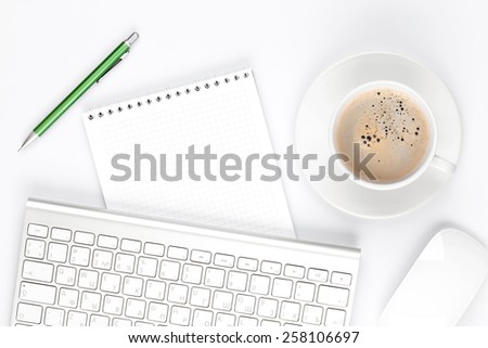 Office desk table with computer, supplies and coffee cup. Top view with copy space - stock photo