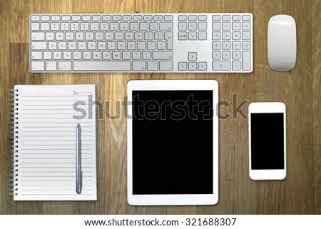 Office desk table with computer. Top view with copy space - stock photo