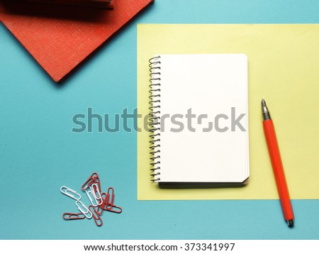 Office desk table with supplies and crumled paper. Top view. Copy space for text - stock photo