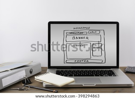 Office desk with a laptop. Website wireframe - stock photo