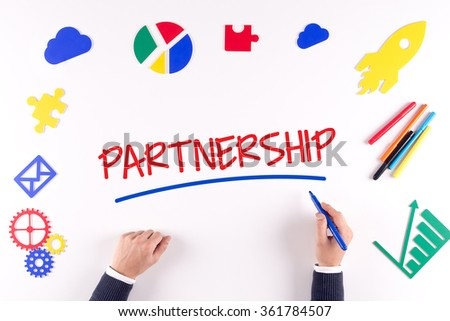Office desk with a single word PARTNERSHIP - stock photo