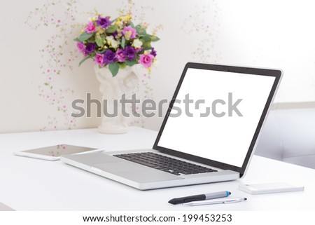office desk with blank screen laptop computer - stock photo