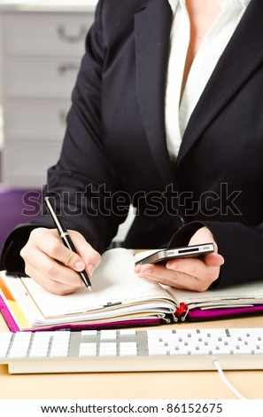 office desk with calender and ballpen - stock photo