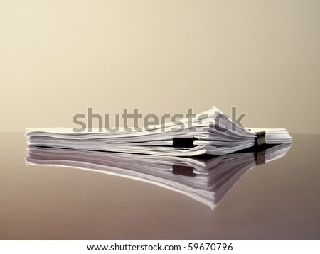 Office desk with files papers and clips - stock photo