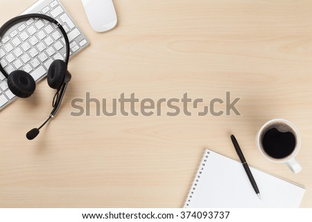 Office desk with headset and supplies. Call center support table. Top veiw with copy space - stock photo