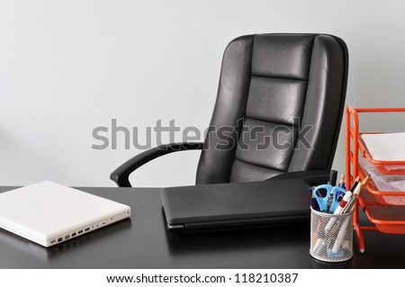 Office desk with two laptops, job or business concept - stock photo
