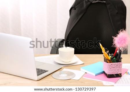 Office desktop in background room - stock photo