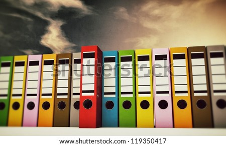 office folders under a cirrus sky - stock photo