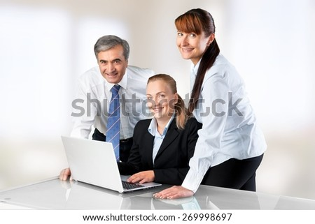 Office. Group Of Three Business People Working - stock photo
