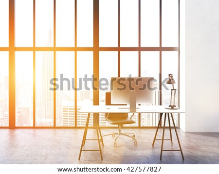 Office interior with computer monitor and lamp on desk, chair, concrete floor and window with New York city view. Toned image. 3D Rendering - stock photo