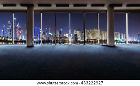 Office interior with panoramic windows revealing Dubai cityscape - stock photo