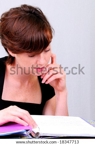 office lady is looking her file - stock photo