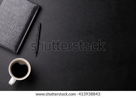 Office leather business desk with coffee cup, notepad and pen. Top view with copy space. Office business table overhead view - stock photo
