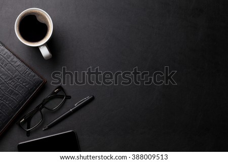 Office leather desk table with coffee and supplies. Top view with copy space - stock photo