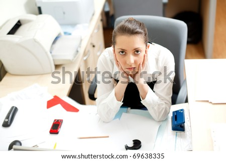 Office life. Tired young woman - stock photo