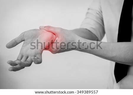 Office Man touching painful wrist. Pain in a man wrist. (Selective Focus) - stock photo