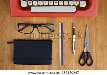 Office Objects And Typewriter On Wooden Table. Flat Lay - stock photo