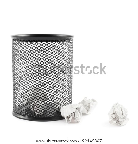 Office paper black trash bin next to crumpled paper isolated over the white background - stock photo