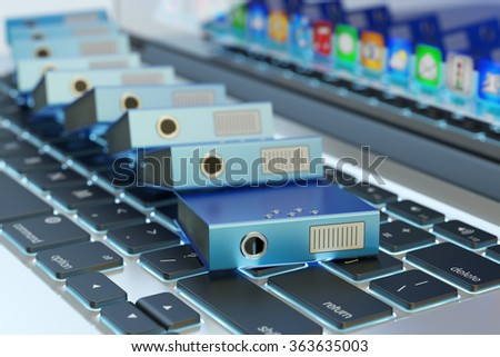 Office paperwork, computer data storage, archive documentation catalog and electronic document management concept, pile of blue ring binders on laptop keyboard - stock photo