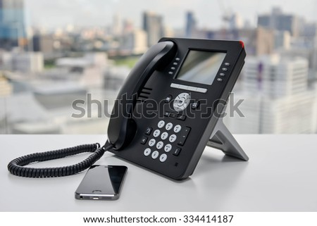 Office Phone and Mobile Phone - stock photo