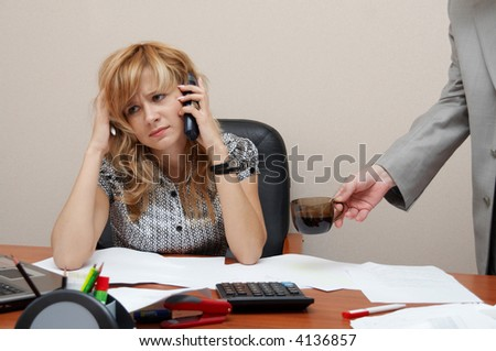 Office. Phone call. Hard working day. Time to coffee break! - stock photo