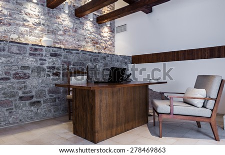 office room interior with desk and armchair - stock photo