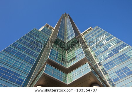 office skyscraper on a background of blue sky - stock photo