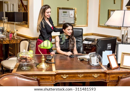 Office staff working together on desktop - stock photo