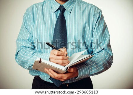 Office staff writes notes in the diary report - stock photo