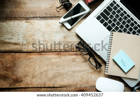 office stuff with mouse smart phone laptop and coffee cup notepad top view shot.  - stock photo