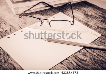 office supplies on old wood table ; vintage process style - stock photo