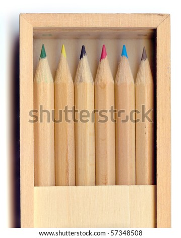 Office supplies: wooden box with six colored pencils - stock photo