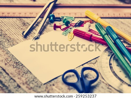 Office supply collection - sharpener, pencils, ball pen, notebooks, pen,scissors,  marker, ruler, copybook, brushes on wooden table background. Back to school, business background - stock photo