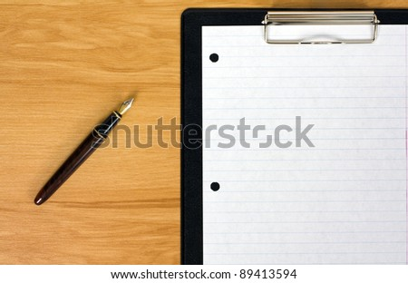 Office table on a wooden background - stock photo