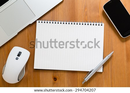 Office table with empty handbook for advertising - stock photo