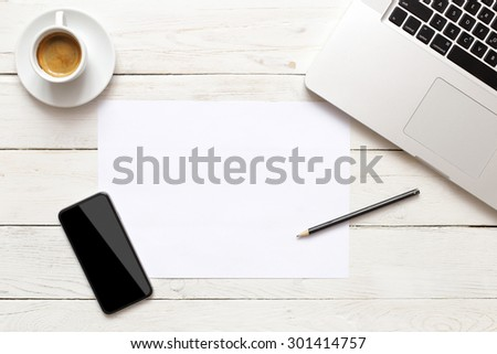 Office table with notepad, computer and coffee cup. - stock photo