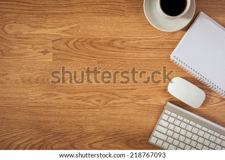 Office table with notepad, computer and coffee cup and computer mouse. View from above with copy space - stock photo