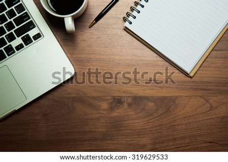 Office table with notepad, computer and coffee cup. View from above. - stock photo