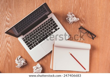 Office table with notepad, computer and coffee cup. View from above with copy space. Vintage color. - stock photo